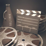 Clapperboard with rolls of film
