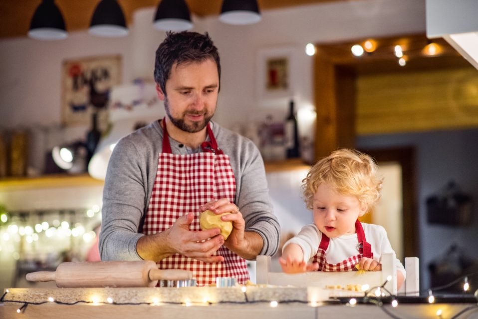 dad and kid making cookies at home