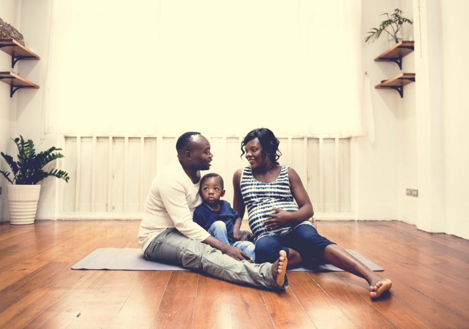 Pregnant woman with husband and son