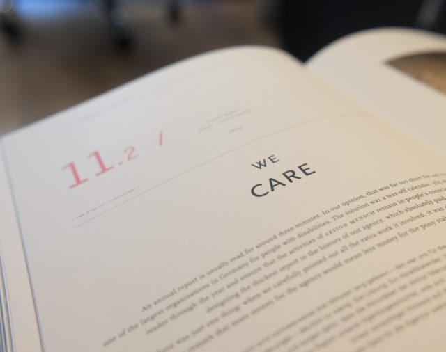 "open book to page that says ""we care"""