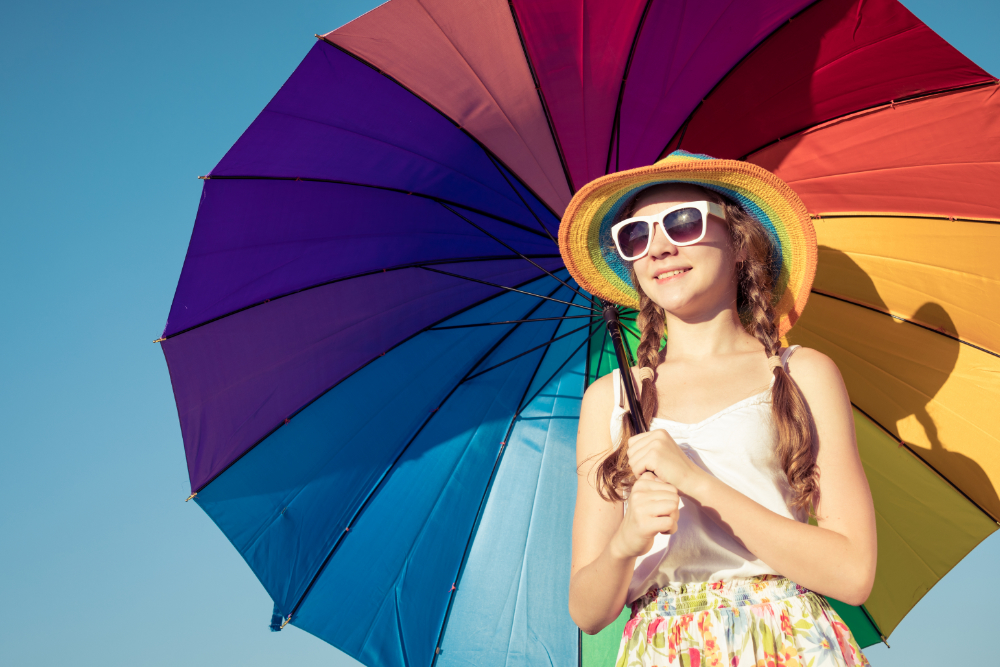 teen girl with colorful umbrella
