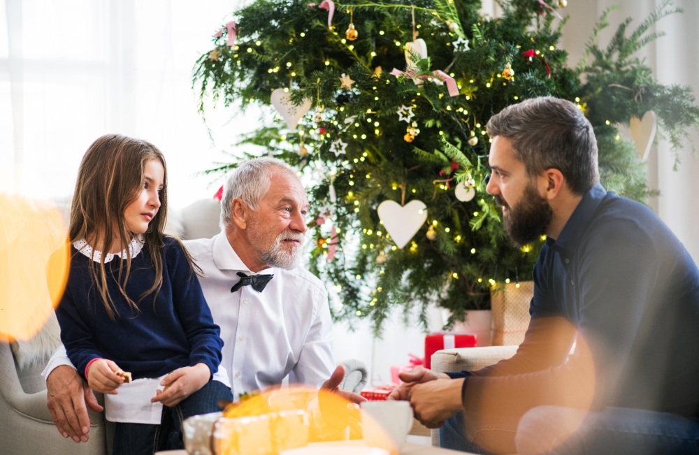 girl sits with grandfather talking to dad about estate planning