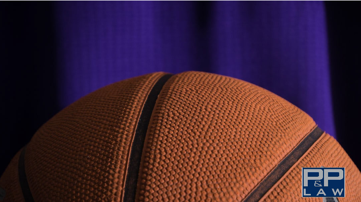 basketball with purple jersey in the background