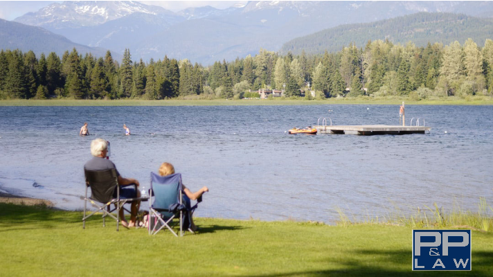 couple retires and enjoys sitting lakeside