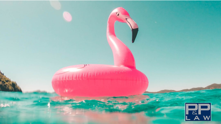 pink inflatable flamingo on clear water during vacation